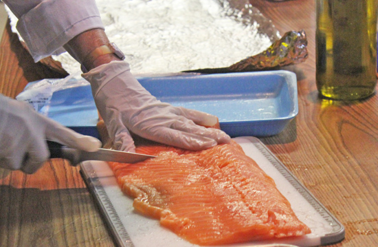 Cut salmon into small portions and lay between two sheets of heavy duty aluminum foil.