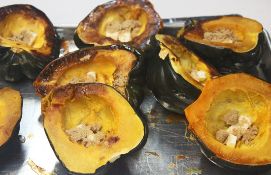 Acorn squashes roasted in the oven. Butter and brown sugar melted in the center.